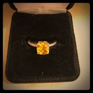 Yellow stone and diamond ring